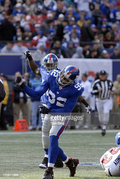 New York Giants defensive end Michael Strahan celebrates after tackling Houston Texans running back Wali Lundy during the Houston Texans vs New York...