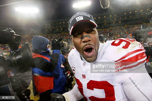 New York Giants' defensive end Michael Strahan celebrates after the Giants' 2320 overtime win over the Green Bay Packers at Lambeau Field The Giants...