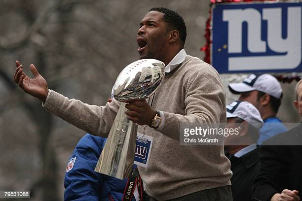 New York Giants defensive end Michael Strahan holds up the Vince Lombardi trophy during the New York Giants Superbowl XLII victory parade February 5,...