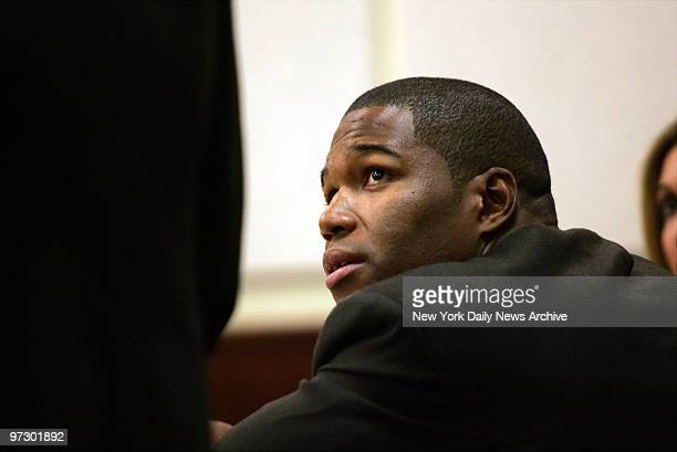 New York Giants' defensive end Michael Strahan looks up at his attorney as he and his estranged wife Jean go through divorce proceedings at Essex...