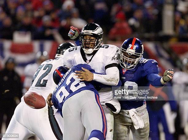 New York Giants' defensive end Michael Strahan sacks Philadelphia Eagles' quarterback Donovan McNabb causing him to fumble in National Football...