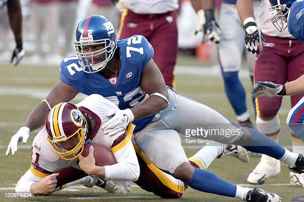 New York Giants defensive end Osi Umenyiora sacking Redskins quaterback Patrick Ramsey during Washington Redskins vs New York Giants game on Sunday...