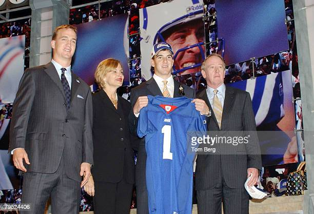 New York Giants draft pick Eli Manning with hisa om brother Peyton Manning and father Archie Manning at the 2004 NFL Draft at Madison Square Garden...