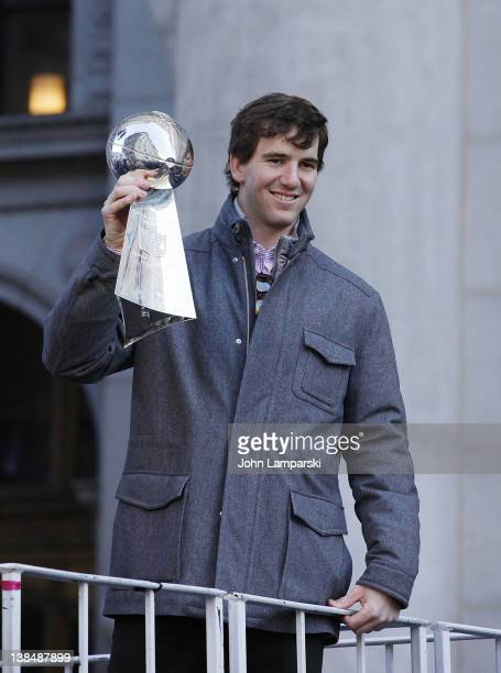 New York Giants Eli Manning holds the Vince Lombardi Trophy during the New York Giants Victory Parade following their Super Bowl XLVI win along the...