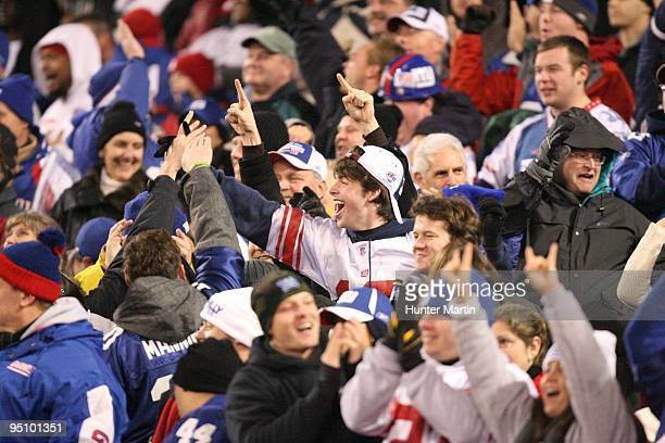 New York Giants fans cheer after a touchdown during a game against the Philadelphia Eagles on December 13 2009 at Giants Stadium in East Rutherford...