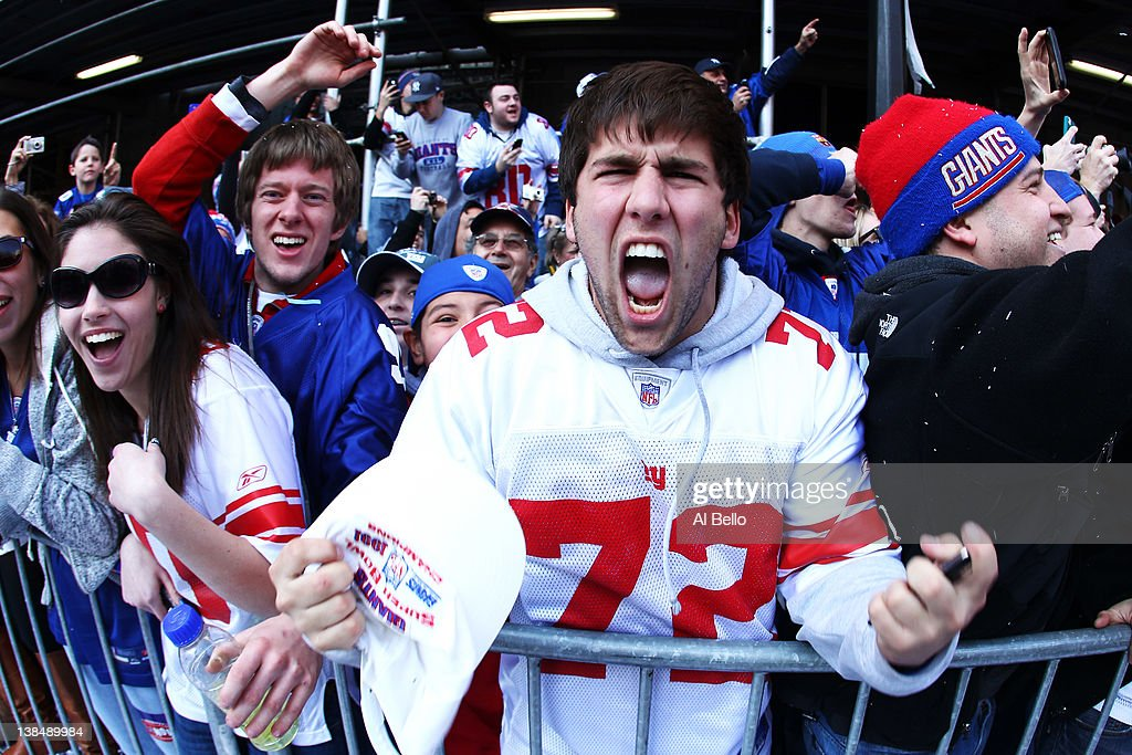 New York Giants fans cheer during the New York Giants ticker tape victory parade down the Canyon of Heros on February 7, 2012 in New York City. The Giants defeated the New England Patriots 21-17 in Super Bowl XLVI at Lucas Oil Stadium on February 5, 2012 in Indianapolis, Indiana.