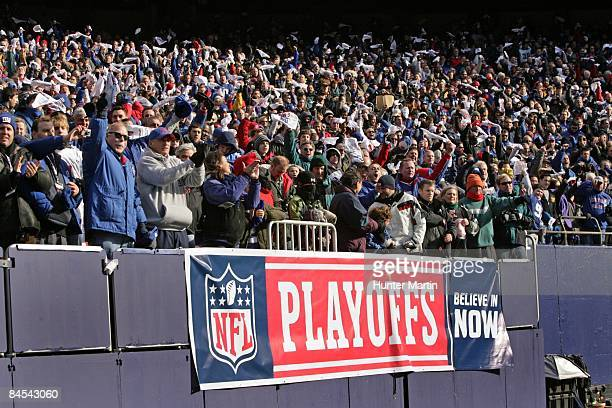 New York Giants fans cheer during the NFC Divisional Playoff game against the Philadelphia Eagles on January 11, 2009 at Giants Stadium in East...