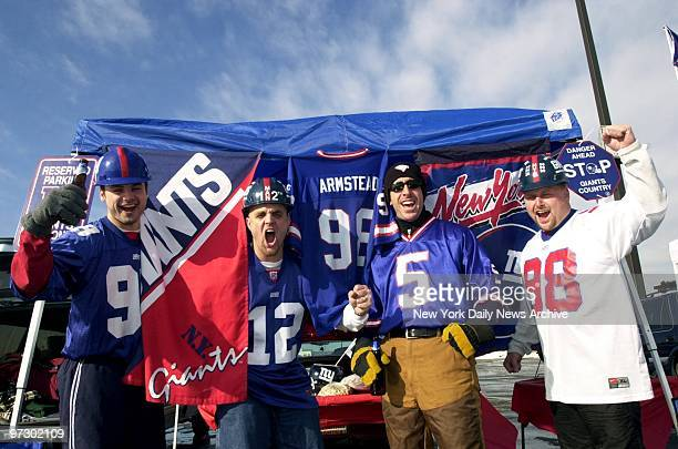 New York Giants' fans Ed Kopera Jerry Foley Dan Graziano and Matt Bucchere are already cheering at tailgate party in parking lot before their team...