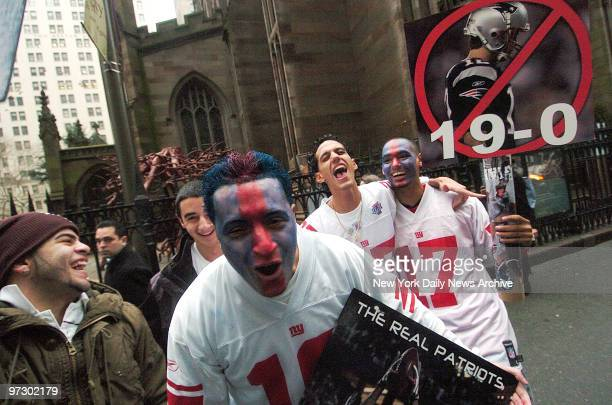 New York Giants fans stand outside Trinity Church for the victory parade along lower Broadway for the Super Bowl XLII champion New York Giants