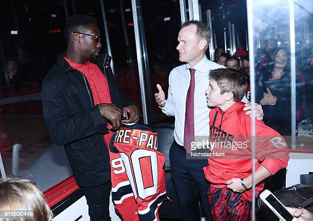 New York Giants Football Player Jason PierrePaul and New Jersey Devils President Hugh Weber attend Anaheim Ducks Vs New Jersey Devils Game October 18...