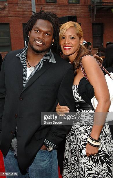 New York Giants football player LaVar Arrington and Trishia Johnson attend the Mission Impossible III premiere in Harlem hosted by BET at the Magic...