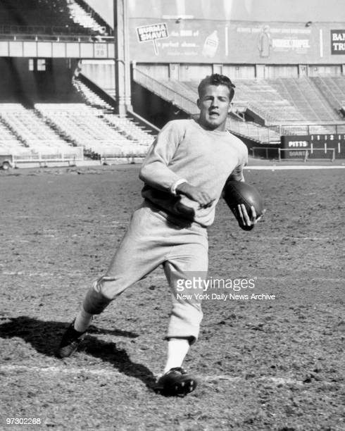 New York Giants' Frank Gifford runs with the ball during practice at Yankee Stadium.