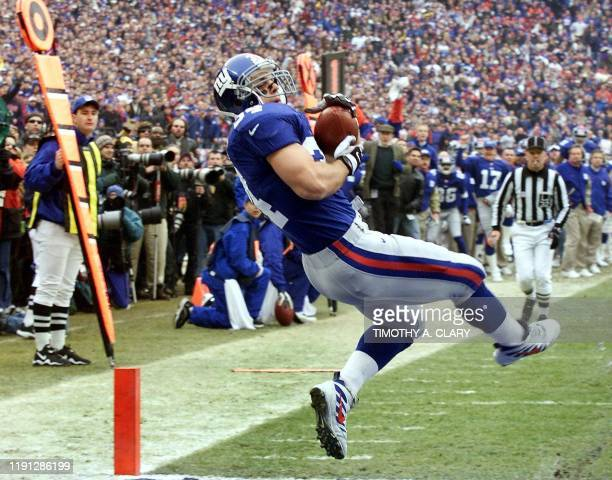 New York Giants' fullback Greg Comella makes the second touchdown reception early in the first quarter of the NFC Championship game against the...