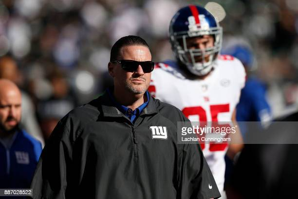 New York Giants head coach Ben McAdoo leaves the field after the Warm up before their game against the Oakland Raiders at OaklandAlameda County...