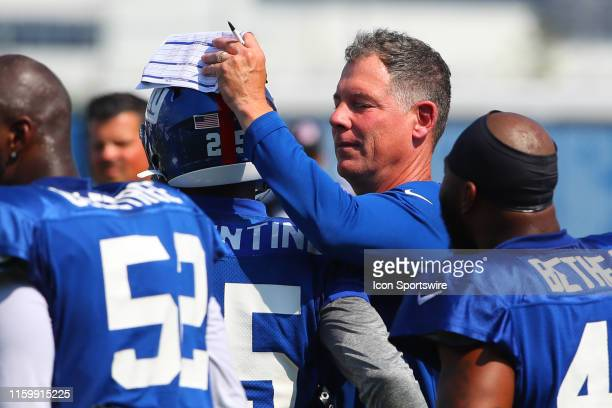 New York Giants head coach Pat Shurmur pats New York Giants defensive back Corey Ballentine on the helmet during New York Giants Training Camp on...