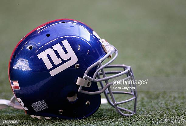 New York Giants helmet sits on the field before the NFC Divisional Playoff game against the Dallas Cowboys at Texas Stadium on January 13, 2008 in...