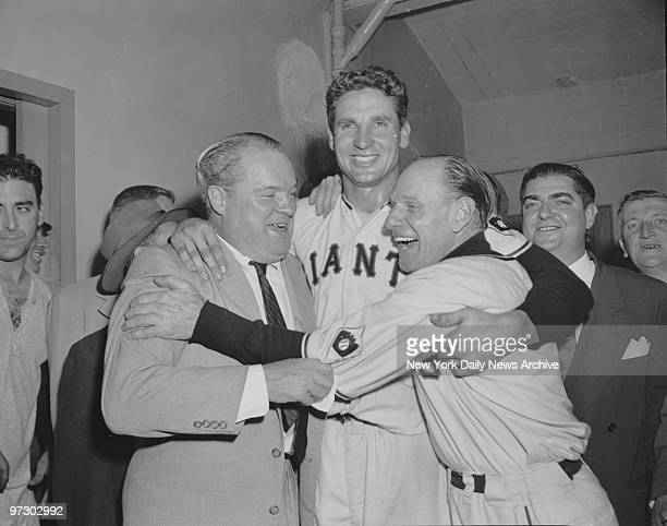New York Giants' hero Bobby Thomson is hugged by team owner Horace Stoneham and manager Leo Durocher . Thomson slugged 3-run homer in the ninth...