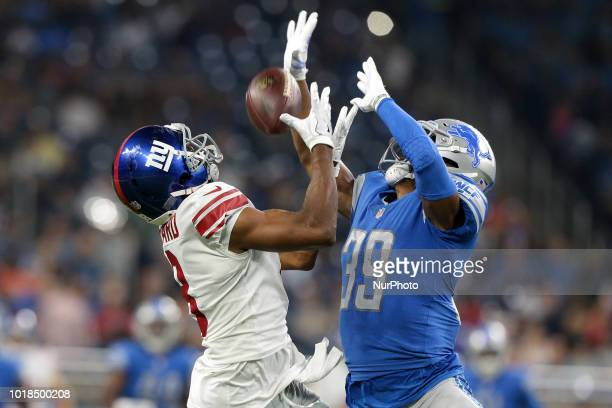 New York Giants kicker Marshall Koehn goes up for a catch guarded by Detroit Lions cornerback Jamal Agnew during the first half of an NFL football...