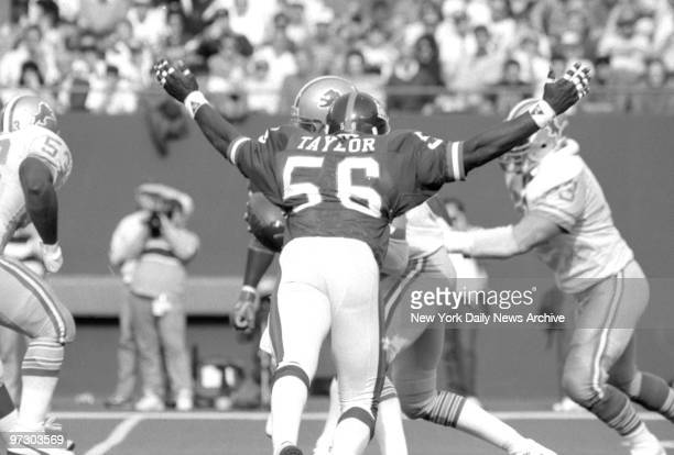 New York Giants' linebacker Lawrence Taylor looks ready to devour Detroit Lions' quarterback Rusty Hilger The young Lion completed only 9 of 28...