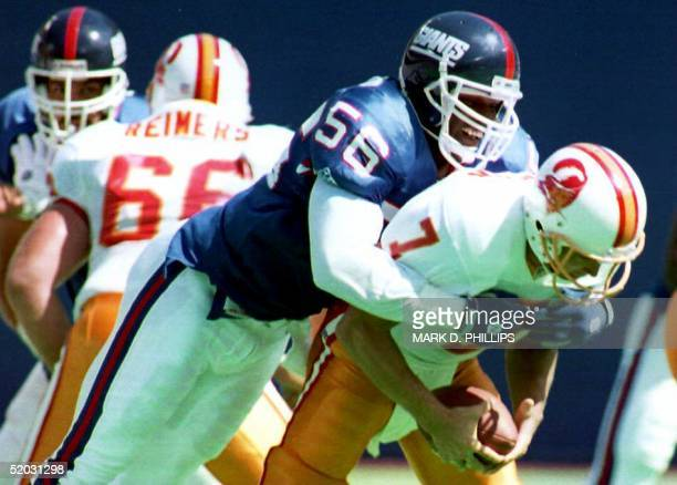 New York Giants linebacker Lawrence Taylor sacks Tampa Bay Buccaneers quarterback Craig Erickson during the second quarter 12 September 1993 in East...