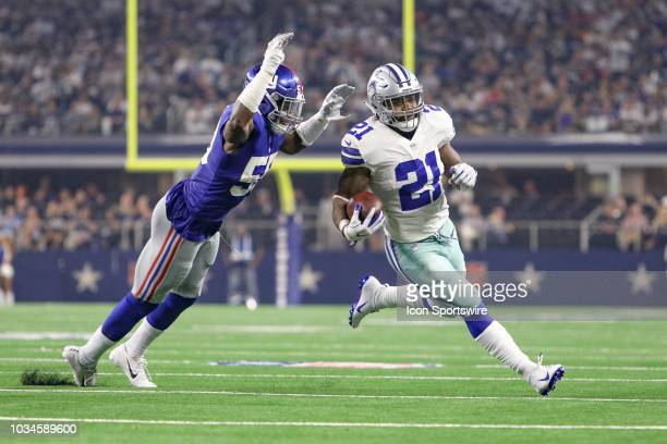New York Giants linebacker Lorenzo Carter leaps to tackle Dallas Cowboys running back Ezekiel Elliott during the game between the New York Giants and...