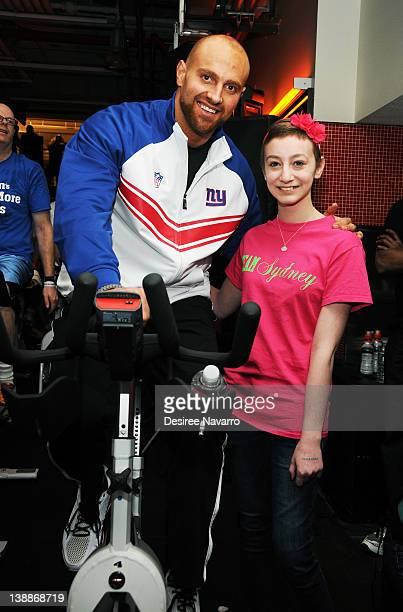 New York Giants Linebacker Mark Herzlich poses with a fan at the 2012 Cycle For Survival Day 2 at Equinox Graybar on February 12 2012 in New York City