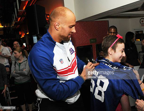 New York Giants Linebacker Mark Herzlich signs a shirt for a fan at the 2012 Cycle For Survival Day 2 at Equinox Graybar on February 12 2012 in New...