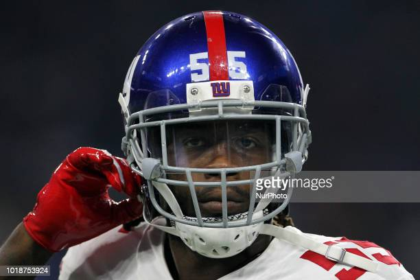 New York Giants linebacker RayRay Armstrong walks off the field after a play during the first half of an NFL football game against the New York...