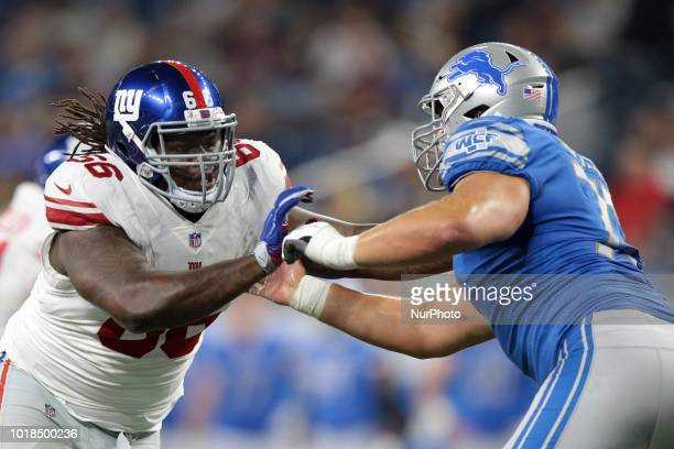 New York Giants Malcom Bunche holds the line against Detroit Lions center Wesley Johnson during the second half of an NFL football game in Detroit...