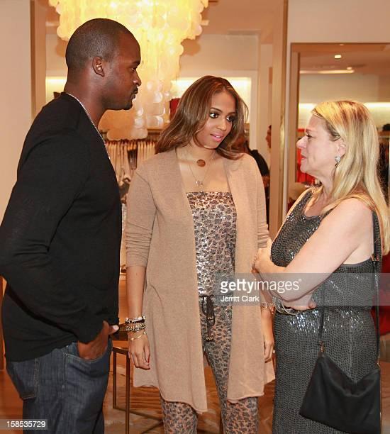 New York Giants' Mathias Kiwanuka and wife Tessa pose with Debbie Bancroft of Calypso St Barth at holiday gifting event with at Calypso St Barth on...