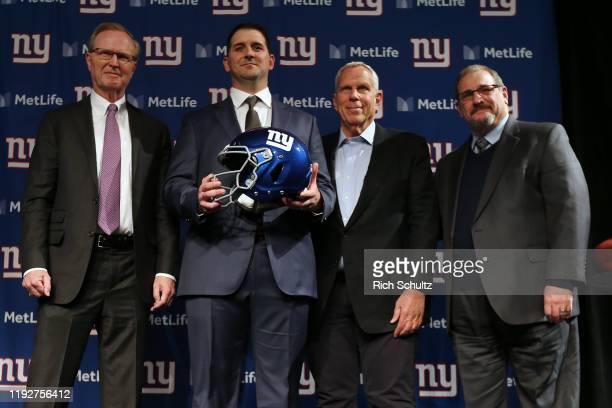 New York Giants new head coach Joe Judge center poses for photographs with team CEO John Mara left chairman and executive vice president Steve Tisch...