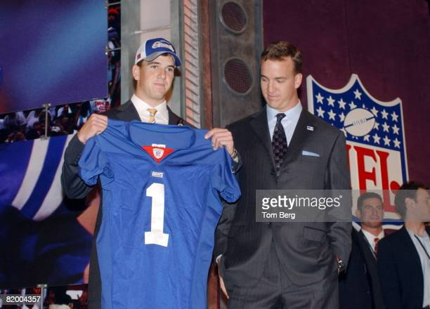 New York Giants number 1 draft choice for 2004 QB Eli Manning poses with his brother Colts quarterback Peyton Manning at the 2004 NFL Draft held at...