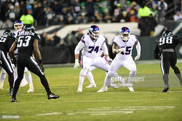New York Giants Offensive Tackle Ereck Flowers and New York Giants Tight End Will Tye set up to block during a National Football League game between...