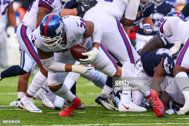 New York Giants offensive tackle Ereck Flowers picks up a loose ball during the National Football League game between the New York Giants and the...