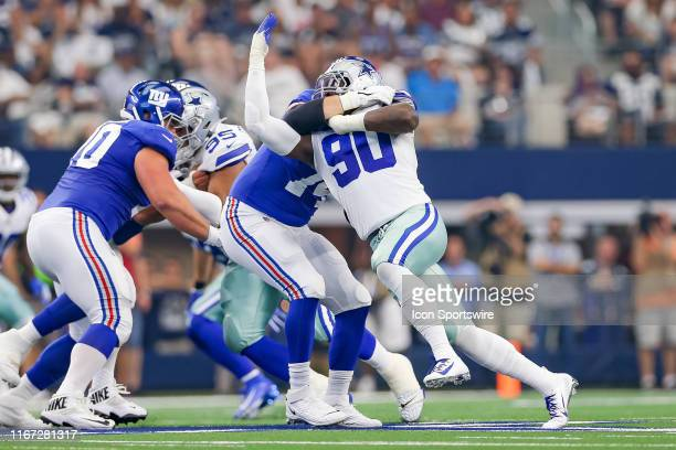 New York Giants Offensive Tackle Mike Remmers attempts to block Dallas Cowboys Defensive End Demarcus Lawrence during the game between the New York...