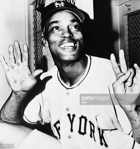 New York Giants outfielder Monte Irvin holds up seven fingers to show the number of hits he has had in two games versus the New York Yankees in the...