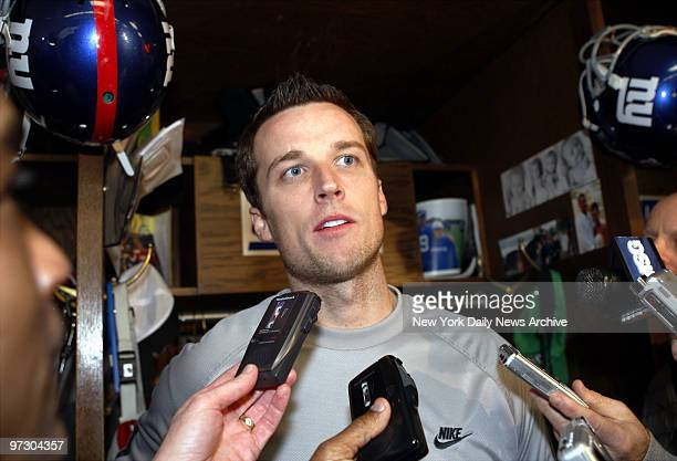 New York Giants' place kicker Lawrence Tynes speaks to media in the locker room at Giants Stadium where the team held a practice in preparation for...