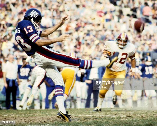 New York Giants punter Dave Jennings kicks the football away during the Giants 2113 loss to the Washington Redskins on November 9 1975 at Shea...