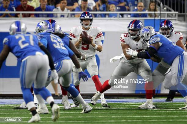 New York Giants punter Riley Dixon looks to throw the ball during the first half of an NFL football game against the New York Giants in Detroit...