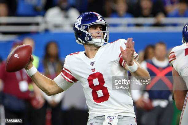 New York Giants quarterback Daniel Jones goes to pass during the second half of an NFL football game against the Detroit Lions in Detroit, Michigan...
