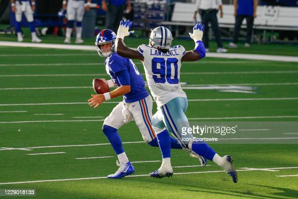New York Giants Quarterback Daniel Jones is chased by Dallas Cowboys Defensive End DeMarcus Lawrence during the NFL game between the New York Giants...