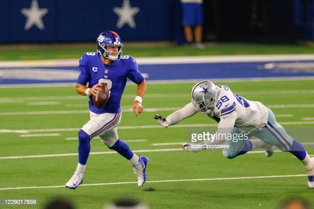 New York Giants Quarterback Daniel Jones is chased out of the pocket by Dallas Cowboys Linebacker Aldon Smith during the NFL game between the New...