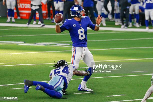 New York Giants Quarterback Daniel Jones throws as Dallas Cowboys Linebacker Jaylon Smith pressures him during the NFL game between the New York...