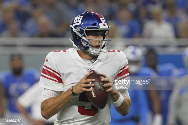 New York Giants quarterback Davis Webb looks to pass during the first half of an NFL football game against the New York Giants in Detroit Michigan...