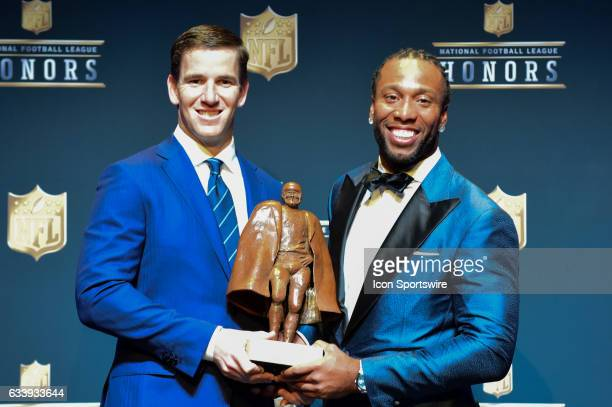 New York Giants quarterback Eli Manning and Larry Fitzgerald of the Arizona Cardinals are named cowinners of the Walter Payton Man of the Year award...