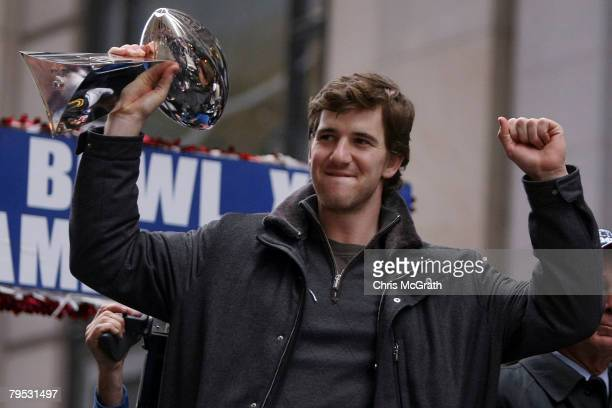 New York Giants quarterback Eli Manning holds up the Vince Lombardi trophy during the New York Giants Superbowl XLII victory parade February 5, 2008...