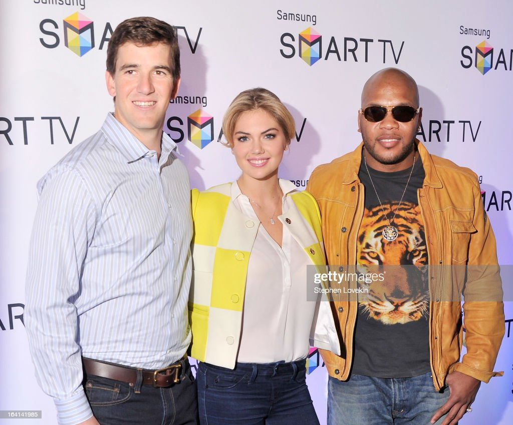 New York Giants Quarterback Eli Manning, model Kate Upton, and singer/rapper Flo Rida attend Samsung's 2013 Television Line Launch Event at Museum Of American Finance on March 20, 2013 in New York City.