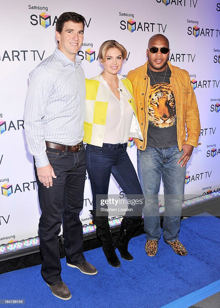 New York Giants Quarterback Eli Manning, model Kate Upton, and singer Flo Rida attend Samsung's 2013 Television Line Launch Event at Museum Of American Finance on March 20, 2013 in New York City.