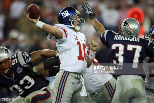 New York Giants quarterback Eli Manning passes the ball during Super Bowl XLII against the New England Patriots at the University of Phoenix Stadium...