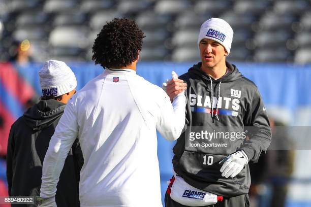 New York Giants quarterback Eli Manning shakes hands with teammate New York Giants tight end Evan Engram during warms up prior to the National...